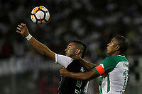 SANTIAGO DE CHILE - CHILE - 27 - 02 - 2018: Octavio Rivero (Izq.) jugador de Colo Colo (CHL) disputa el balón con Alexis Henriquez (Der.) jugador de Atletico Nacional (COL), durante partido de la Fase de Grupos, grupo 2, fecha 1 entre Colo Colo (CHL) y Atletico Nacional (COL), por la Copa Conmebol Libertadores 2018 en el estadio Monumental David Arellano, de la ciudad de Santiago de Chile. / Octavio Rivero (L) player of Colo Colo (CHL), vies for the ball with Alexis Henriquez (R) player Atletico Nacional (COL), during match of the Group Stage, group 2, 1st date between Colo Colo (CHL) and Atletico Nacional (COL) for Copa Conmebol Libertadores 2018 at the David Arellano Monumental Stadium, in the city of Santiago de Chile. Photos: VizzorImage / Marcelo Hernandez / Cont. / Photosport