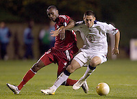 1/22/06, San Diego, California, USA vs Canada--..USA\'s Clint Dempsey holds off Canada\'s Atiba Hutchinson in the first half of a 0-0 tie. ..