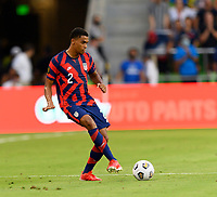 AUSTIN, TX - JULY 29: Reggie Cannon #2 of the United States passes the ball to a teammate during a game between Qatar and USMNT at Q2 Stadium on July 29, 2021 in Austin, Texas.