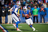 Buffalo Bills Isaiah McKenzie (19) takes a handoff from quarterback Josh Allen (17) during an NFL football game against the New York Jets, Sunday, December 9, 2018, in Orchard Park, N.Y.  (Mike Janes Photography)