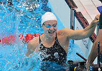 July 28, 2012: Melanie Schlanger of Australia reacts after winning the  women's 4x100m Freestyle Relay by setting a new Olympic record at the Aquatics Center on day one of 2012 Olympic Games in London, United Kingdom.