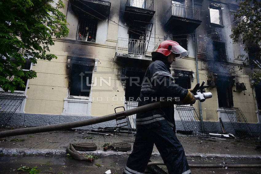 Firefighters extinguish flames inside the Mariupol police headquarters  after a molotov cocktail attack.<br /> <br /> Ukraine's security forces claimed to have killed 21 pro-Russian separatists in Mariupol on one of the bloodiest military repression since the so called anti-terror operation inception.
