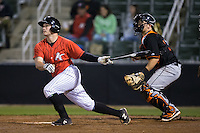 Zach Fish (24) of the Kannapolis Intimidators follows through on his swing against the Delmarva Shorebirds at Kannapolis Intimidators Stadium on April 12, 2016 in Kannapolis, North Carolina.  The Shorebirds defeated the Intimidators 2-1.  (Brian Westerholt/Four Seam Images)