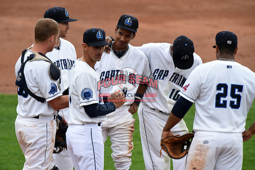 Lake County Captains manager Mark Budzinski (7) makes a pitching change as Richard Stock (28), Paul Hendrix (8), Ivan Castillo (9), Claudio Bautista (10) and Nellie Rodriguez (25) look on during a game against the Dayton Dragons on June 8, 2014 at Classic Park in Eastlake, Ohio.  Lake County defeated Dayton 4-2.  (Mike Janes/Four Seam Images)