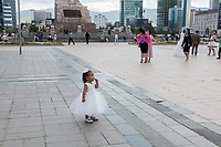 Mongolia, Ulaanbaatar. Sukhbaatar Square, little girl.