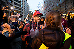 "Pro-Trump and anti-Trump demonstrators argue near Black Lives Matter Plaza during the ""Million MAGA March"" on November 14, 2020 in Washington, D.C.  Thousands of supporters of U.S. President Donald Trump gathered to protest the results of the 2020 presidential election won by President-Elect Joe Biden.  Photograph by Michael Nagle"