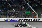 NASCAR Camping World Truck Series<br /> Toyota Tundra 250<br /> Kansas Speedway, Kansas City, KS USA<br /> Friday 12 May 2017<br /> Kyle Busch, Cessna Toyota Tundra takes the checkered flag and the win<br /> World Copyright: Nigel Kinrade<br /> LAT Images<br /> ref: Digital Image 17KAN1nk07771
