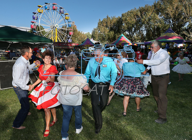 Square dancers perform at the NV150 Fair at Fuji Park, in Carson City, Nev., on Friday, Aug. 1, 2014.<br /> Photo by Cathleen Allison