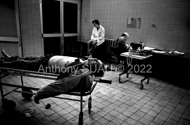 Moscow, Russia.Emergency ward.1994.A patient lost to a heart attack.