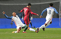 Leiria, Portugal - Tuesday November 14, 2017: John Brooks, Gonçalo Guedes during an International friendly match between the United States (USA) and Portugal (POR) at Estádio Dr. Magalhães Pessoa.