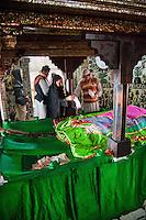 Fatehpur Sikri, Uttar Pradesh, India.  Inside the Mausoleum of Sheikh Salim Chishti a Worshiper Sprinkles Rose Petals on the Tomb.