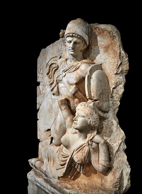 Roman Sebasteion relief  sculpture of emperor Claudius and Britannia, Aphrodisias Museum, Aphrodisias, Turkey.   Against a black background.<br /> <br /> Naked warrior emperor Claudius is about to deliver a death blow to the slumped Britannia. He wears a helmet, cloak and sword belt with a scabbard. Britannia wears a tunic with one breast exposed like the Amazon figures she was modelled on. The inscription reads: Tiberios Klaudios Kaiser - Bretannia.