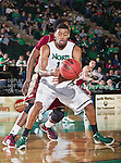 North Texas Mean Green forward Tony Mitchell (13) in action during the game between the Denver Pioneers and the University of North Texas Mean Green at the North Texas Coliseum,the Super Pit, in Denton, Texas. UNT defeated Denver 75 to 74 in overtime.