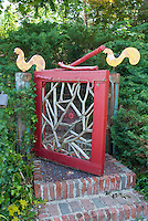 Garden gate entry, whimsical fun homemade artistic with steps of brick, and bird ornaments roosters
