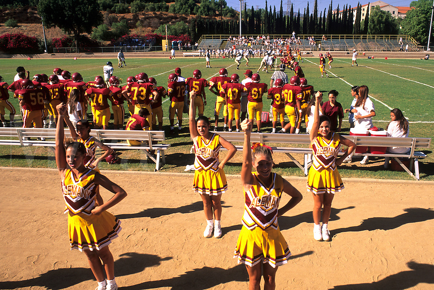 Cheerleaders leading cheer for high school football game in Los Angeles Californi