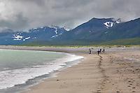 Hiking along the sandy beach of coastal Katmai National Park, Alaska Peninsula, southwest Alaska.