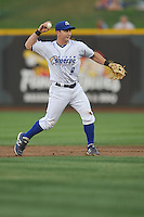 Omaha Storm Chasers second baseman Johnny Giavotella #9 throws to first base during the game against the Reno Aces at Werner Park on August 3, 2012 in Omaha, Nebraska.(Dennis Hubbard/Four Seam Images)