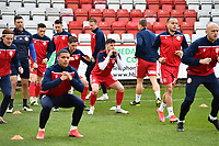 Stevenage Players arrive on the pitch during Stevenage vs Barrow, Sky Bet EFL League 2 Football at the Lamex Stadium on 27th March 2021