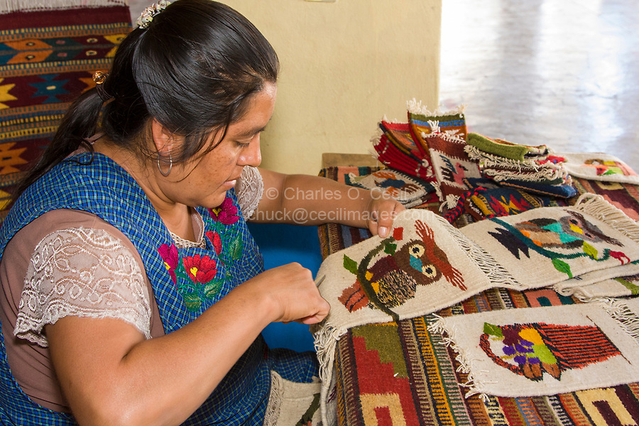 Santa Ana del Valle, Oaxaca, Mexico, North America.  Zapotec Woman at work on Woven Wall-Hangings, Owl Design.