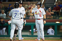Glendale Desert Dogs Willie Calhoun (7), of the Los Angeles Dodgers organization, congratulated by teammates Trey Michalczewski (8) and Paul DeJong (16) after hitting a home run during a game against the Scottsdale Scorpions on October 14, 2016 at Scottsdale Stadium in Scottsdale, Arizona.  Scottsdale defeated Glendale 8-7.  (Mike Janes/Four Seam Images)