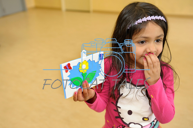 Avani Martinez, 4, of Sparks, shows off her artwork done during Nevada Wildflower Family Fun Day at the Nevada State Museum in Carson City Saturday April 11, 2015. Visitors to the museum were treated to loads of information, hands-on experiences and crafts.<br />
