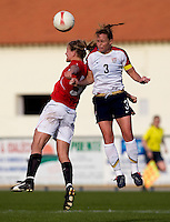 USWNT captain (3) Christie Rampone goes up for a header against Norwegian midfielder (5) Anneli Giske during the last group stage game in the Algarve Cup.  The USWNT defeated Norway, 1-0, in Ferreiras, Portugal. Photo by Brad Smith/ isiphotos.com