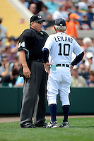 Detroit Tigers manager Jim Leyland #10 talks with umpire Jerry Layne during a Spring Training game against the New York Mets at Joker Marchant Stadium on March 11, 2013 in Lakeland, Florida.  New York defeated Detroit 11-0.  (Mike Janes/Four Seam Images)