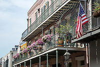 French Quarter, New Orleans, Louisiana.  Balcony with Flowers and Flag.
