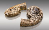 Two decorated terra cotta seashell shaped vessels found in the house of Assyrian trader, Elamma, at the second level of the Karum of Kultepe. - 19th to 17th century BC - Kültepe Kanesh - Museum of Anatolian Civilisations, Ankara, Turkey. Against a grey background.