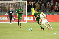 PORTLAND, OR - MARCH 01: Diego Valeri #8 of the Portland Timbers dribbles the ball away from Ethan Finlay #13 of Minnesota United during a game between Minnesota United FC and Portland Timbers at Providence Park on March 01, 2020 in Portland, Oregon.