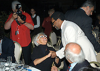 SPIKE LEE & LINA WERTMULLER .The Film Award Sesterzio Silver 2008 held at the Jardin de Russie,.Rome 24th June 2008..half length glasses white frames cross necklace cream suit pinstripe shaking hand photographer sitting.CAP/CAV.©Luca Cavallari/Capital Pictures