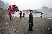 CHINA. Sichuan Province. Chongqing. Tourists on the banks of  the Yangtze river which is at its lowest level in 150 years as a result of a country-wide drought. Chongqing is a city of over 3,000,000 people, famed for being the capital of China between 1938 and 1946 during World War II. It is situated on the banks of the Yangtze river, China's longest river and the third longest in the world. Originating in Tibet, the river flows for 3,964 miles (6,380km) through central China into the East China Sea at Shanghai.  2008