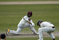 16th April 2021; Emirates Old Trafford, Manchester, Lancashire, England; English County Cricket, Lancashire versus Northants; Saif Zaib of Northamptonshire sweeps as Rob Jones of Lancashire takes evasive action
