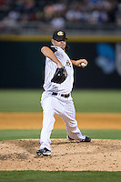 Charlotte Knights relief pitcher Zach Phillips (21) in action against the Norfolk Tides at BB&T BallPark on April 9, 2015 in Charlotte, North Carolina.  The Knights defeated the Tides 6-3.   (Brian Westerholt/Four Seam Images)