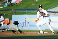 West Michigan Whitecaps Aaron Westlake #24 takes a pick off throw as Matt Rice #9 dives back during a game against the Bowling Green Hot Rods at Fifth Third Ballpark on June 26, 2012 in Comstock Park, Michigan.  West Michigan defeated Bowling Green 13-11.  (Mike Janes/Four Seam Images)