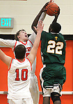 Manogue's D.K. White shoots over Douglas defenders Hunter Myers and Trevor Shaffer during a boys basketball game between Bishop Manogue and Douglas High in Minden, Nev., on Thursday, Dec. 22, 2011..Photo by Cathleen Allison