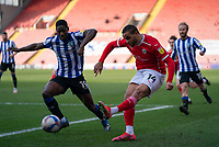 20th March 2021, Oakwell Stadium, Barnsley, Yorkshire, England; English Football League Championship Football, Barnsley FC versus Sheffield Wednesday; Carlton Morris of Barnsley crosses from the byline after beating Osaze Urhoghide of Sheffield Wednesday