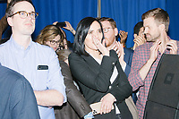 Senior communications advisor Lis Smith watches as Democratic presidential candidate and former South Bend, Ind., mayor Pete Buttigieg speaks at his Primary Night rally at Nashua Community College in Nashua, New Hampshire, on Tue., Feb. 11, 2020. Democratic presidential candidate and Vermont senator Bernie Sanders was projected to win the New Hampshire Democratic Primary, but Buttigieg came in a close second.
