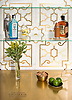 Jardin de Versailles, a waterjet stone mosaic, shown in polished Calacatta Gold and Brass, is part of the Jardins Français™ collection by Caroline Beaupere for New Ravenna.<br /> -counter courtesy of Grothouse Solid Wood Surfaces<br /> www.glumber.com