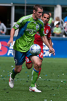 Nate Jaqua (L) of the Seattle Sounders works the ball against Dwayne De Rosario(14) of Toronto FC in the match at the XBox Pitch at Quest Field on August 29, 2009. The Sounders and Toronto played to a 0-0 draw.