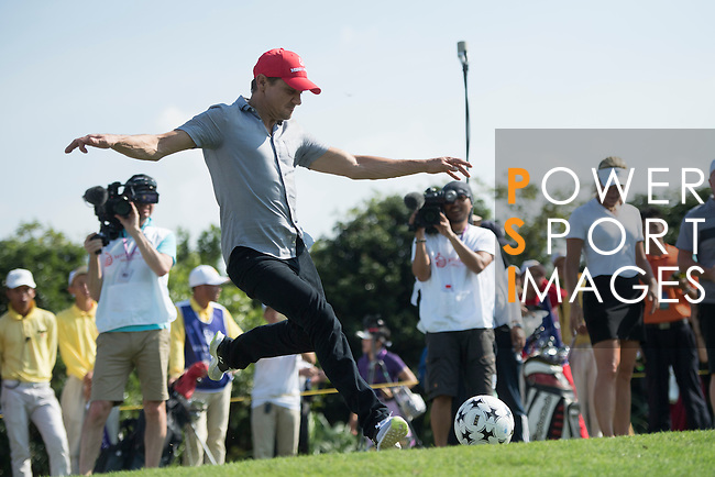 Jeremy Renner kicks a football at the 14th hole during the World Celebrity Pro-Am 2016 Mission Hills China Golf Tournament on 22 October 2016, in Haikou, China. Photo by Weixiang Lim / Power Sport Images