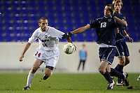 Ido Ligety (14) of the St. John's Red Storm and Matt Margiotta (13) of the Villanova Wildcats. St. John's defeated Villanova 2-0 during the second semifinal match of the Big East Men's Soccer Championships at Red Bull Arena in Harrison, NJ, on November 11, 2011.