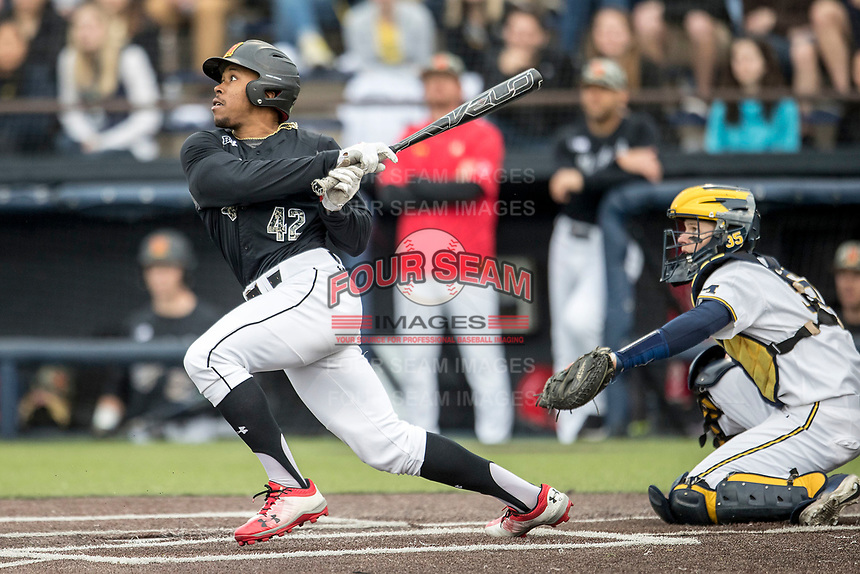 Maryland Terrapins outfielder Marty Costes (42) follows through on his swing against the Michigan Wolverines on April 13, 2018 in a Big Ten NCAA baseball game at Ray Fisher Stadium in Ann Arbor, Michigan. Michigan defeated Maryland 10-4. (Andrew Woolley/Four Seam Images)