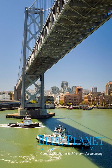 tug boats under Bay Bridge in San Francisco, California, USA, Pacific Ocean