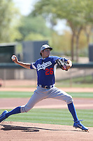 James Baune #26 of the Los Angeles Dodgers pitches during a Minor League Spring Training Game against the Cleveland Indians at the Los Angeles Dodgers Spring Training Complex on March 22, 2014 in Glendale, Arizona. (Larry Goren/Four Seam Images)
