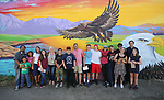 Mural artist Abner Rivera poses with a group of Boys & Girls Club members during a tour of local murals in Carson City, Nev., on Monday, July 31, 2017. Mark Salinas, Carson City's art and culture coordinator and the Adams Hub sponsored the tour. <br /> Photo by Cathleen Allison/Nevada Photo Source