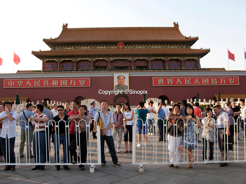 An extraordinary few number of people who wait to see the flag descending ceremony are seen waiting in the northern part of Tiananmen Square at 6:30pm. .03 Jun 2009