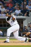 Michael Taylor (45) of the Charlotte Knights follows through on his swing against the Gwinnett Braves at BB&T Ballpark on August 6, 2014 in Charlotte, North Carolina.  The Knights defeated the Braves  12-10.  (Brian Westerholt/Four Seam Images)