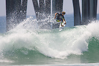 American Oliver Kurtz boosts an air in front of the pielings during round of 96 at the 2010 US Open of Surfing in Huntington Beach, California on August 4, 2010.