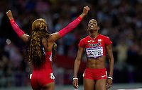 05 AUG 2012 - LONDON, GBR - Sanya Richards-Ross (USA) (left) of the USA celebrates winning the women's 400m final with bronze medalist DeeDee Trotter (USA) (right) also of the USA during the London 2012 Olympic Games athletics in the Olympic Stadium at the Olympic Park in Stratford, London, Great Britain .(PHOTO (C) 2012 NIGEL FARROW)